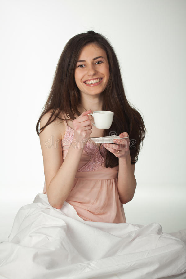 Smiling Girl In The Bed With A Cup Of Coffee Royalty Free Stock Image