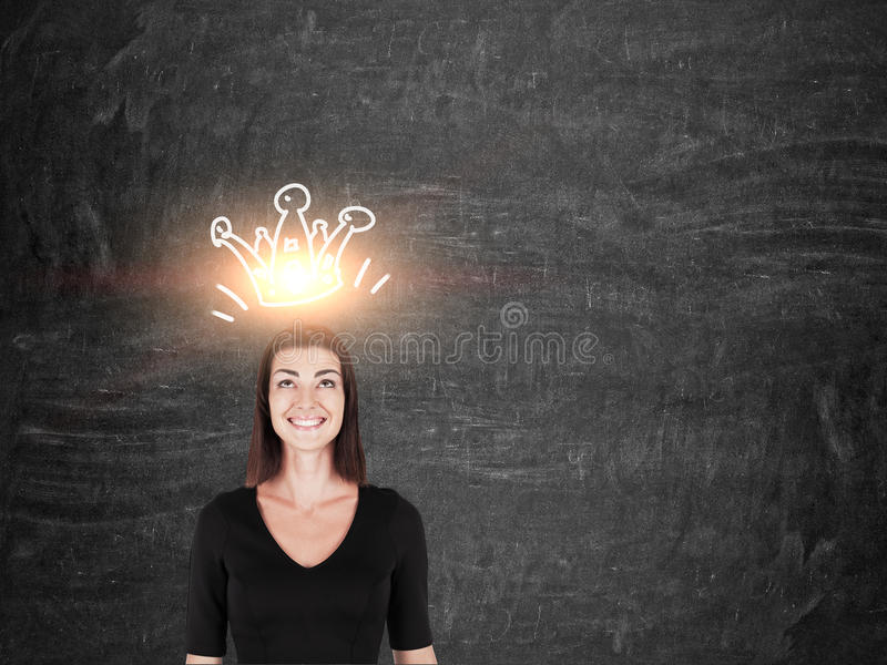 Smiling girl in black with crown stock image