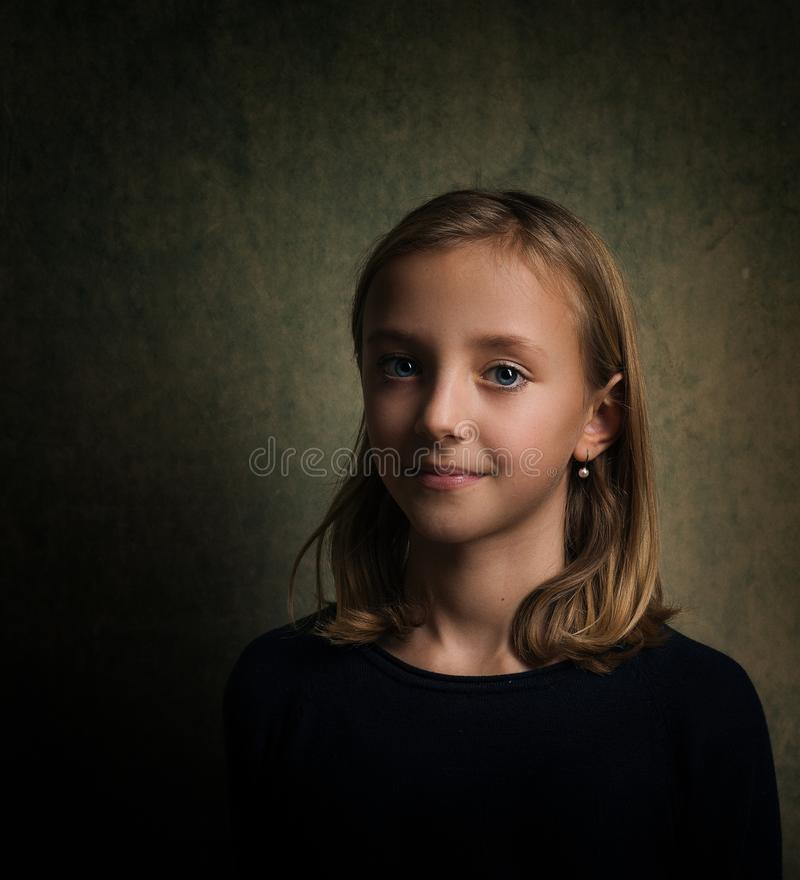 Smiling Girl With Blonde Hair Wearing Black Crew-neck Shirt royalty free stock images