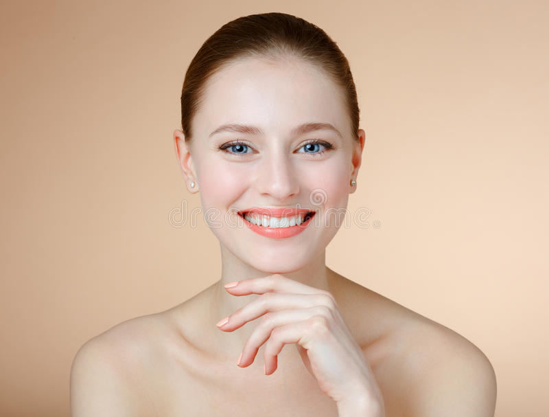 Smiling girl with blue eyes. royalty free stock photography