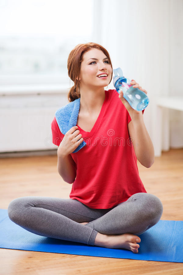 Download Smiling Girl With Bottle Of Water After Exercising Stock Image - Image: 40265461