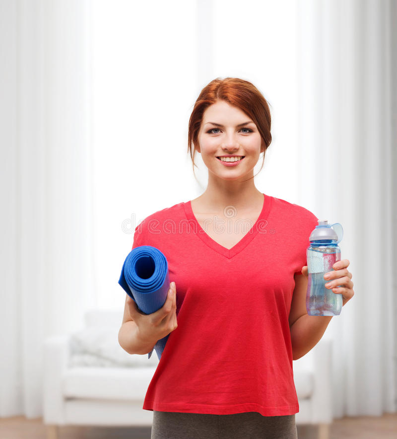 Download Smiling Girl With Bottle Of Water After Exercising Stock Photo - Image: 40264612