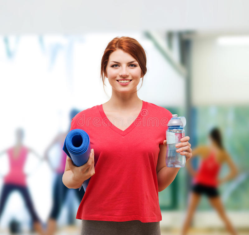 Smiling Girl With Bottle Of Water After Exercising Stock Photo