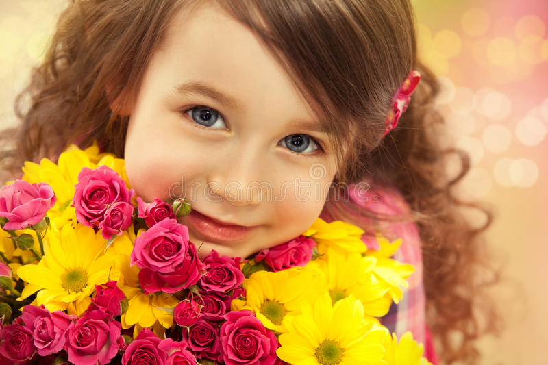 Smiling girl with a bouquet of flowers stock image