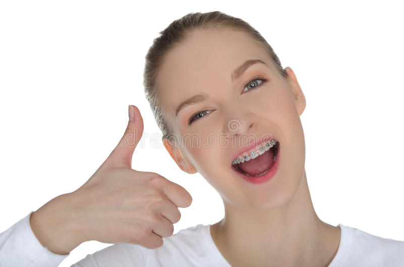 Smiling girl with braces. Isolated on white stock photo