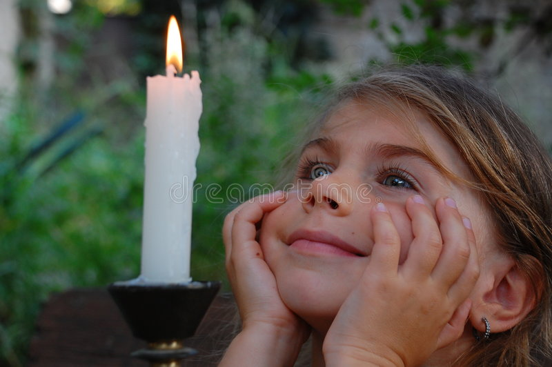 Smiling Girl and candle royalty free stock photography