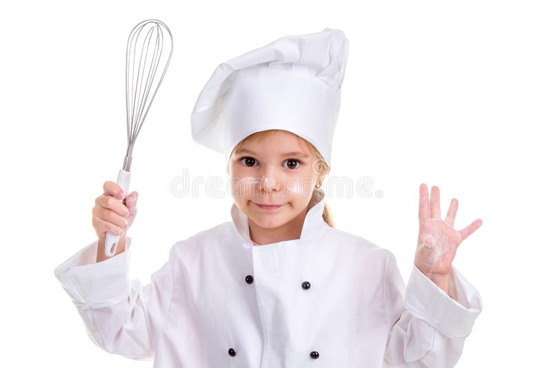 Smiling girl chef white uniform isolated on white background. Floured face. Holding the whisk in one hand and another. Palm up floured. Landscape image stock photography