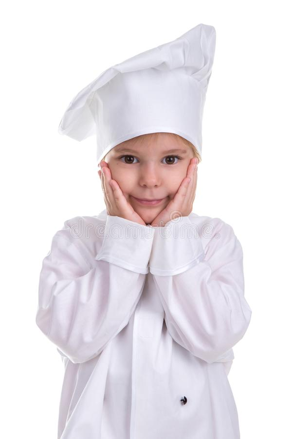 Smiling girl chef white uniform isolated on white background, holding hands under the chin. Portrait image stock photography