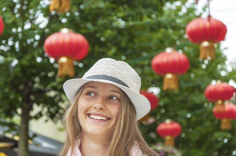 Smiling girl at the chinese restaurant royalty free stock photos