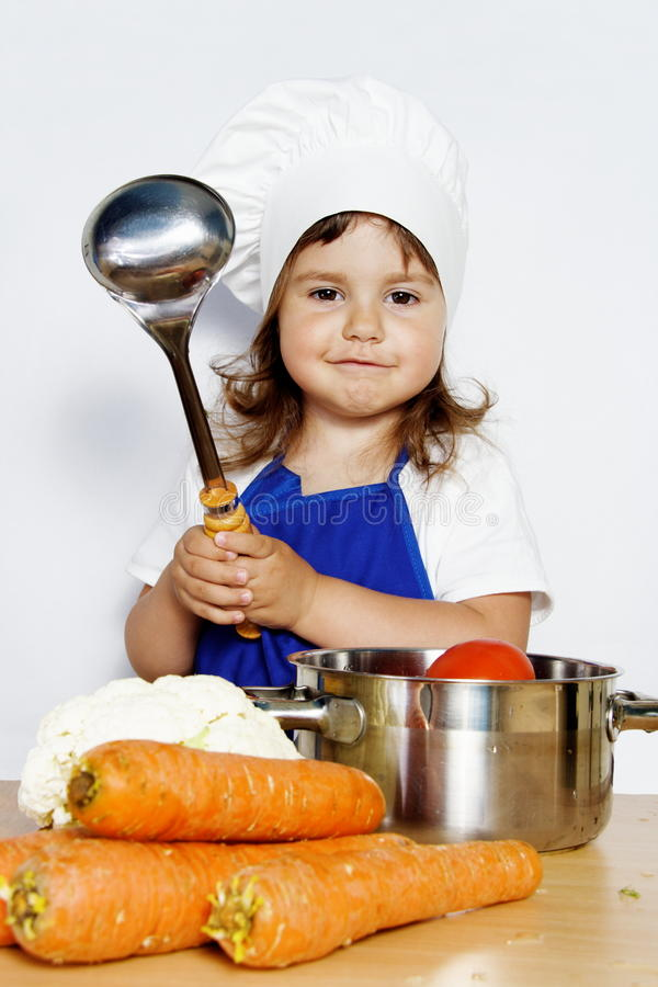 Download Smiling Girl In Cook's Cap Preparing Food Stock Image - Image: 19639621