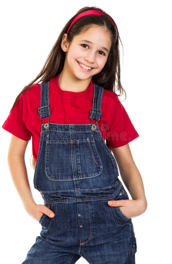 Smiling girl in coveralls. Isolated on white stock image