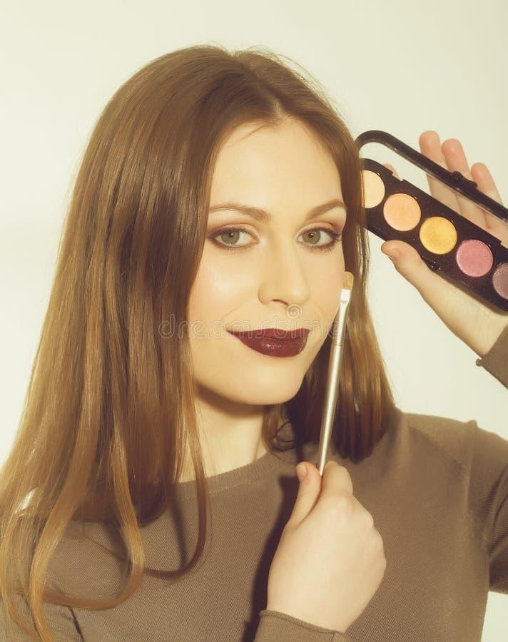 Young Woman Smiling Applying Eyeshadow Stock Photo Image