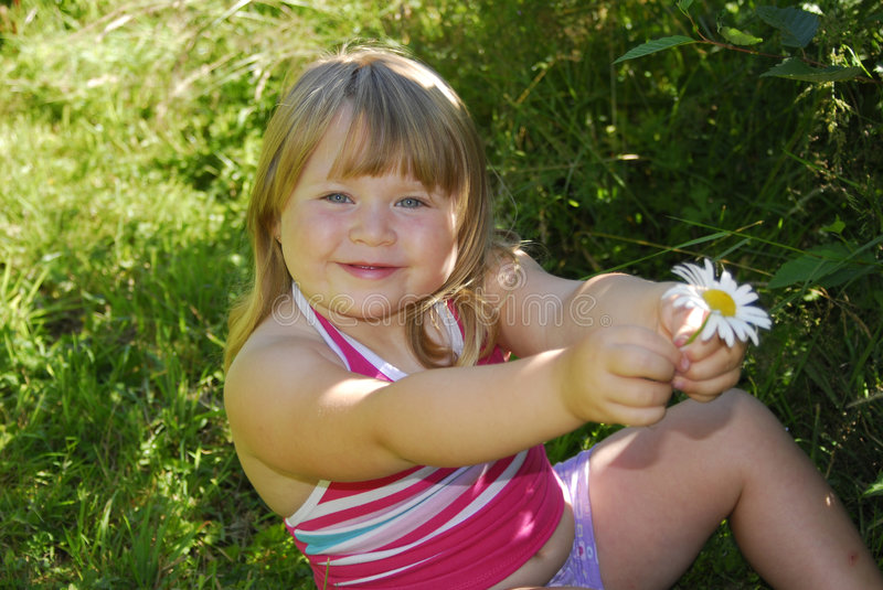 Download Smiling girl with daisy stock photo. Image of countryside - 1241372