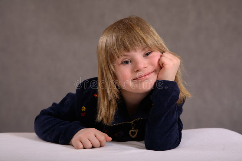 Smiling Girl with Disability stock photo