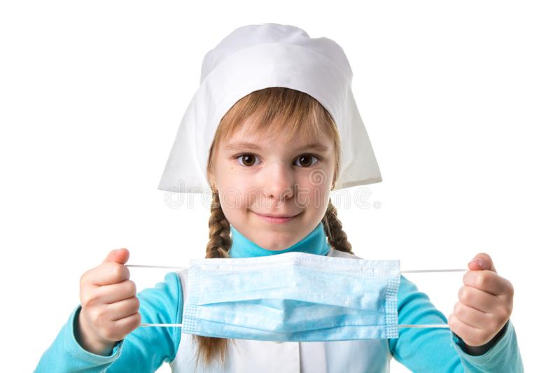 Smiling girl doctor dresses a mask on a white landscape background stock photos