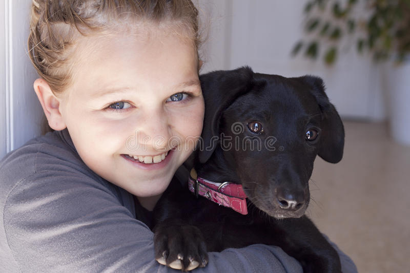 Smiling girl with dog stock photos