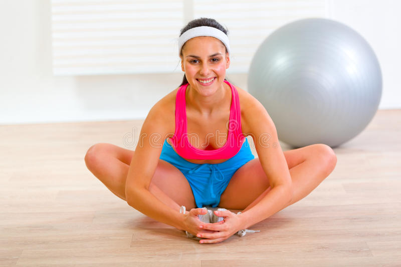 Download Smiling Girl Doing Stretching Exercises At Home Stock Photo - Image of ball, female: 21102846