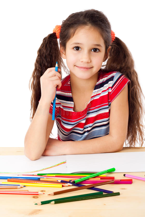 Smiling girl draw the rainbow. Smiling girl at the table draw the rainbow, isolated on white royalty free stock images