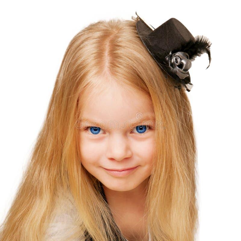 Smiling girl in elegant black hat royalty free stock image