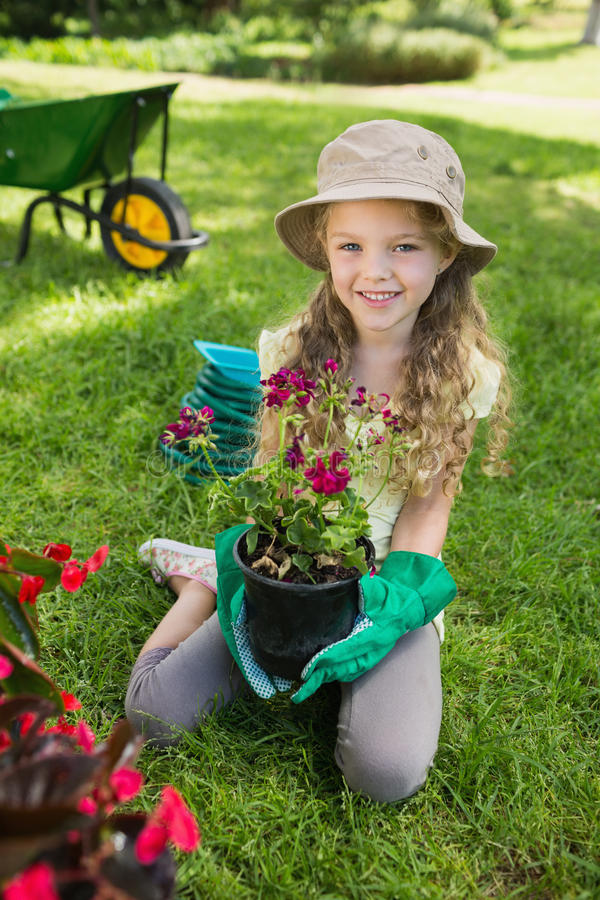 Smiling girl engaged in gardening stock photography