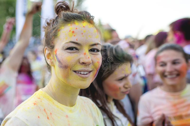 Smiling girl enjoying The Color Run Bucharest. Happiest 5k on the planet!. Colorful picture from Romania at The Color Run Bucharest the most colorful race where royalty free stock photography