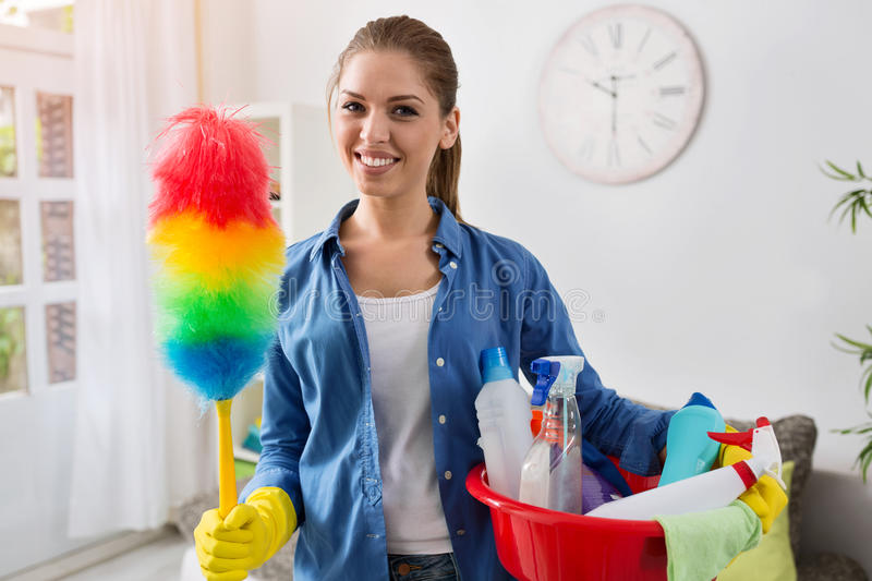 Smiling girl with the equipment for cleaning stock photo