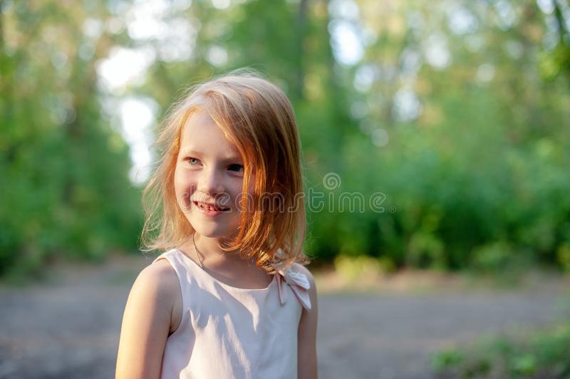 Smiling girl in the forest. Smiling redhead girl in the forest stock photography