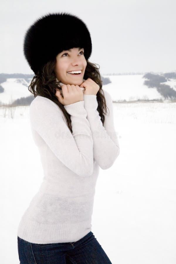 Smiling girl in fur cap royalty free stock image