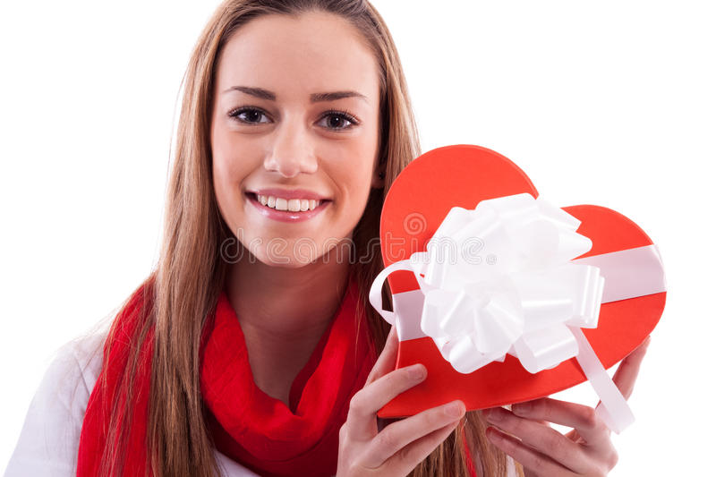 Smiling girl with gift heart royalty free stock photos