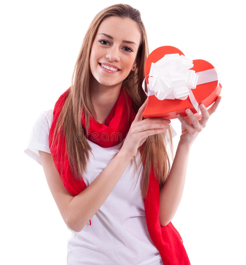 Smiling girl with gift heart royalty free stock image