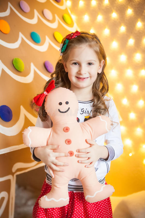 Smiling girl with a gingerbread man royalty free stock image