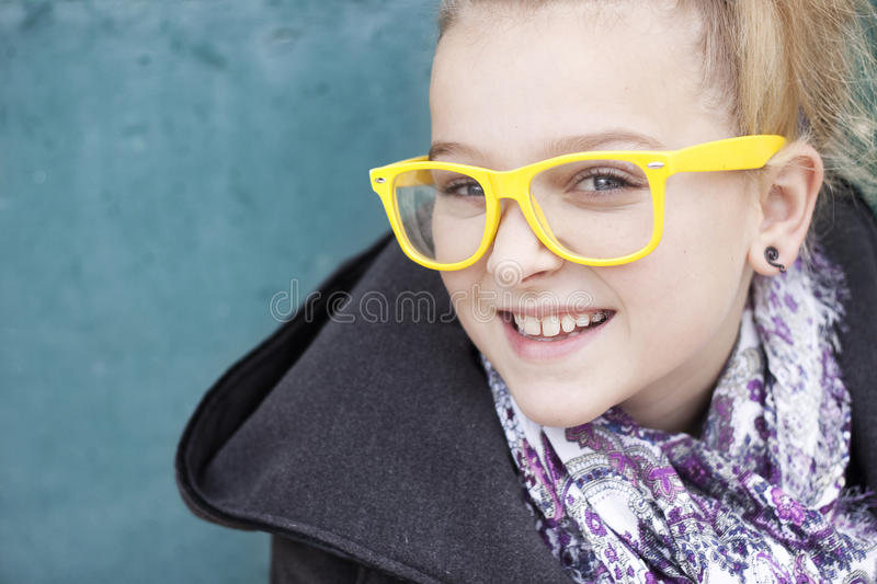 Smiling girl with glasses stock photography
