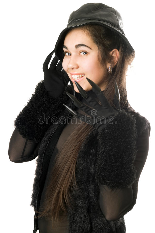 Smiling girl in gloves with claws. Isolated royalty free stock photography