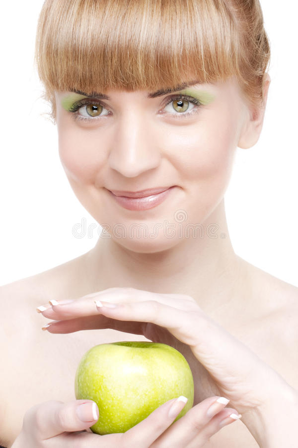Smiling girl with green apple stock photos