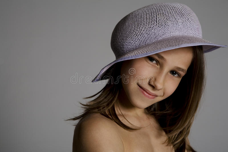 Download Smiling girl in hat stock image. Image of grey, smiles - 12506473