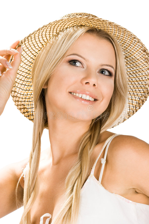 Smiling girl with a hat stock photography