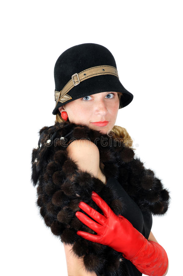Smiling girl in hat and red gloves stock images