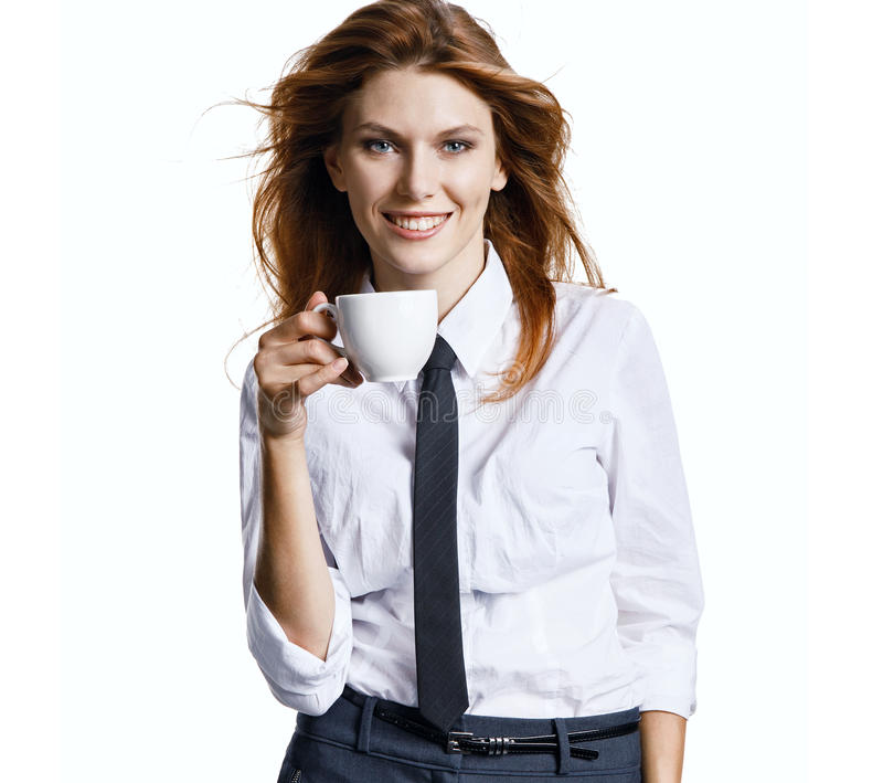 Smiling girl have coffee time. Photo of pretty businesswoman holding porcelain cup with coffee - isolated on white background stock image