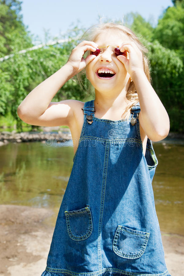 Smiling girl having picknick on the riverside stock photo