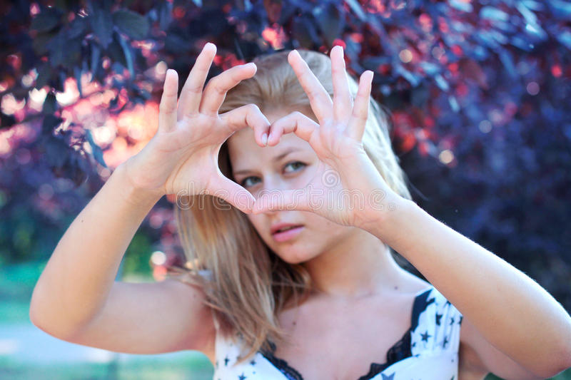Download Smiling Girl With Heart Sign Stock Photo - Image: 24063756