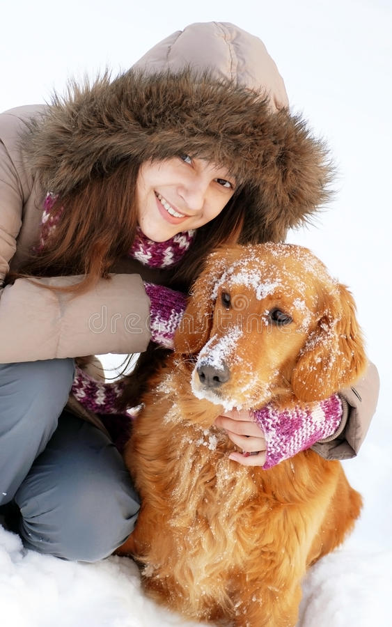 Smiling girl and her dog royalty free stock images