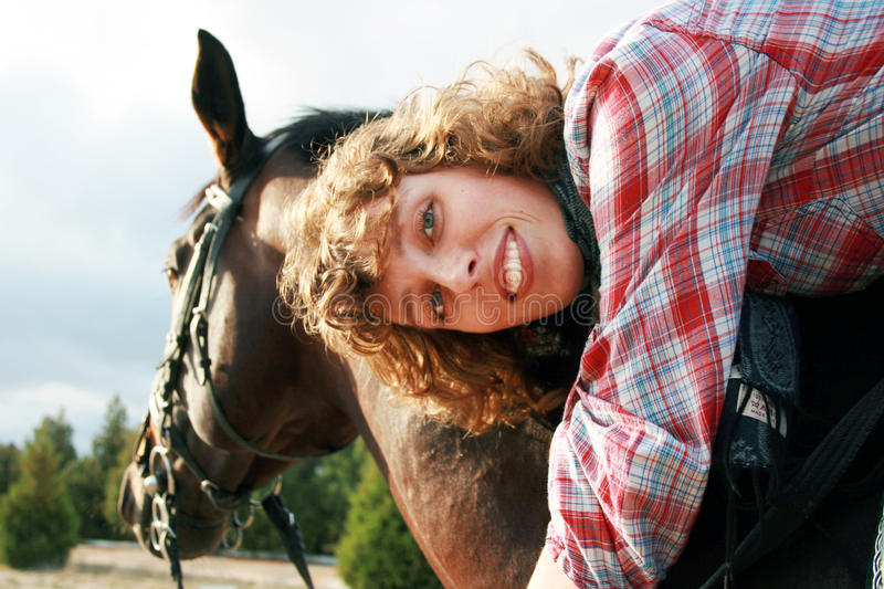 Download Smiling girl on her horse stock image. Image of freestyle - 12442527