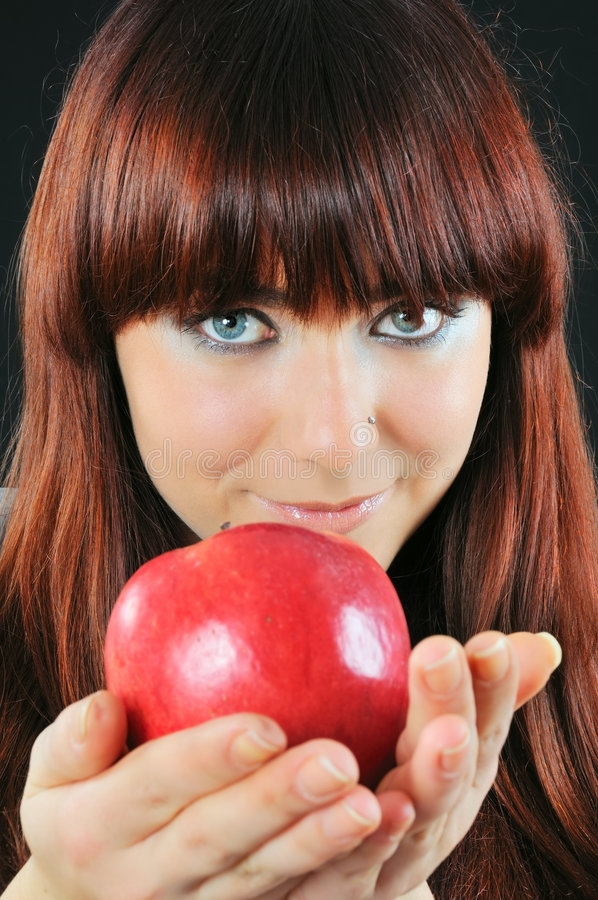 Free Smiling Girl Hold Apple Stock Images - 7153864