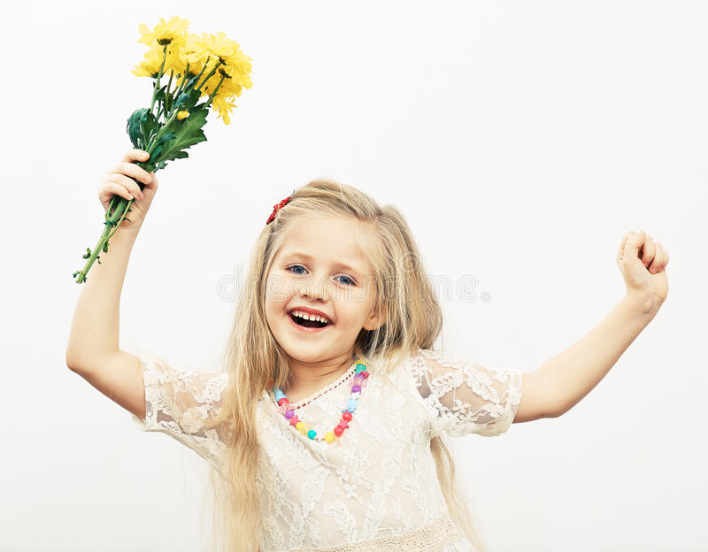 Smiling Girl hold yellow flowers. royalty free stock photography
