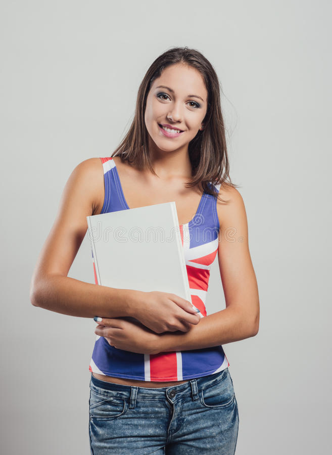 Smiling girl holding a book stock images