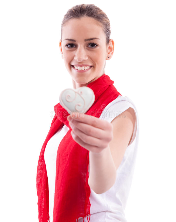 Smiling girl holding candy heart royalty free stock photos