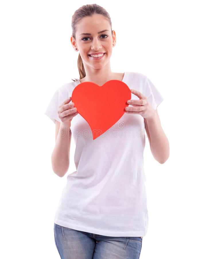 Smiling girl holding heart royalty free stock photography