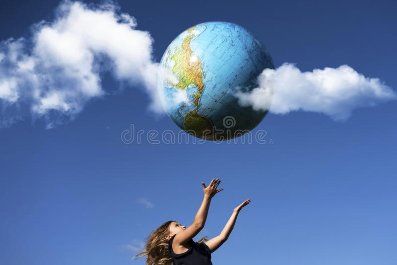 Smiling girl holding planet Earth stock images