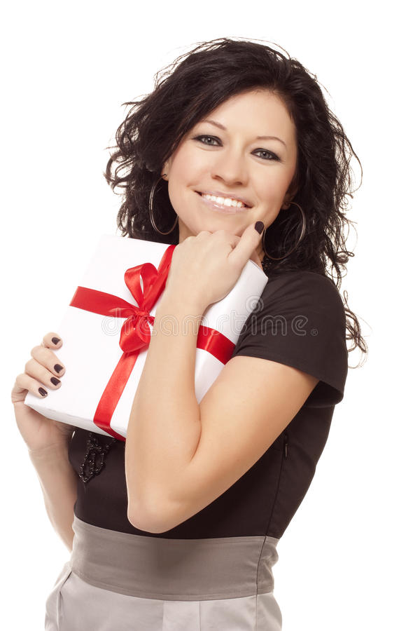 Smiling girl holds a gift royalty free stock images