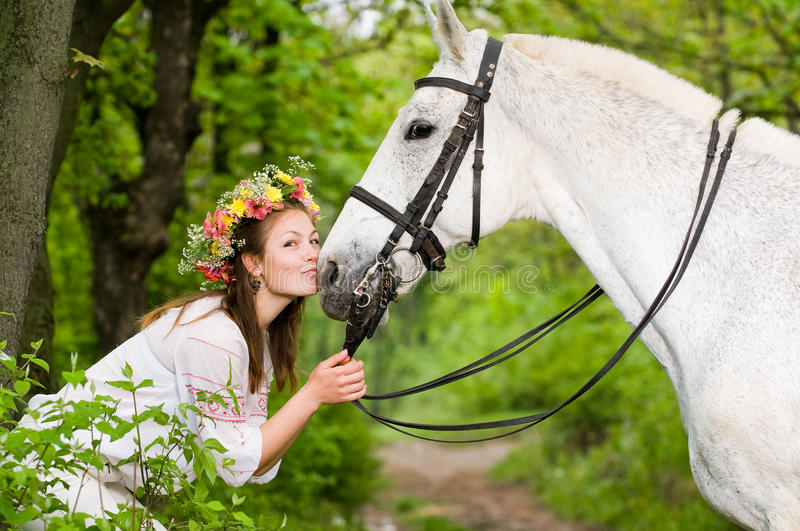Smiling girl with horse. In the forest stock photos